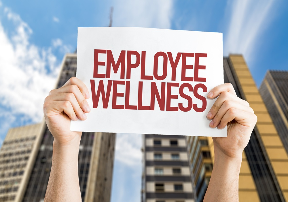 Employee Benefits placard with cityscape background