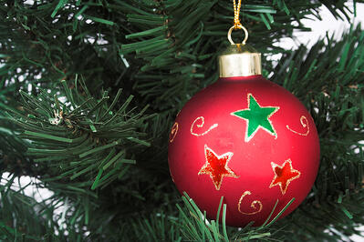 Red christmas ball over a tree